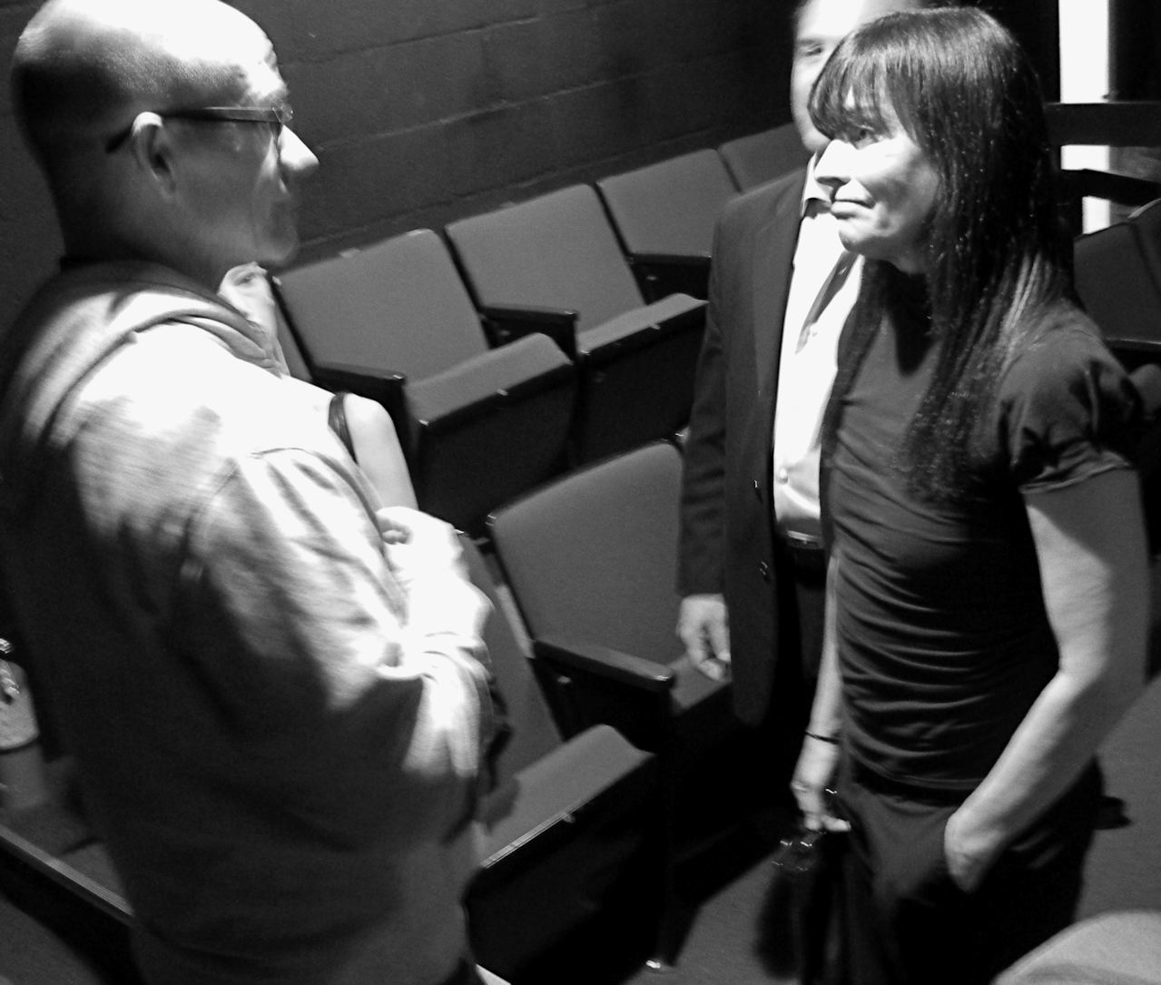 """Playwright Gary Lennon talking with actor Diane Venora at the staged reading of """"A Family Thing.""""  Photo by Kam Miller."""
