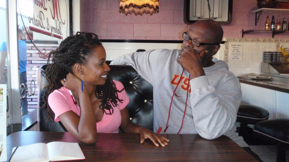 Actress Shanola Hampton talks with writer-director Charles Murray on the set.  Photo courtesy of Charles Murray.