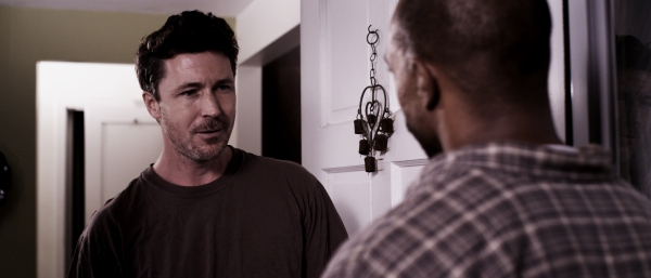 "Actor Aidan Gillen as the kinky Ray and Michael Beach as the repressed Hollis Wallace in ""Scrapper.""  Photo courtesy of Grinning Man Media Group."