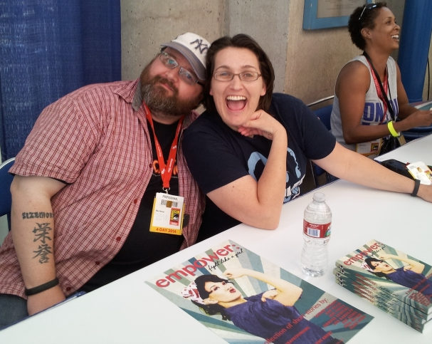 Hulu's Caper creator Amy Berg shares a moment with a fan. Photo credit: Timothy Elliott.