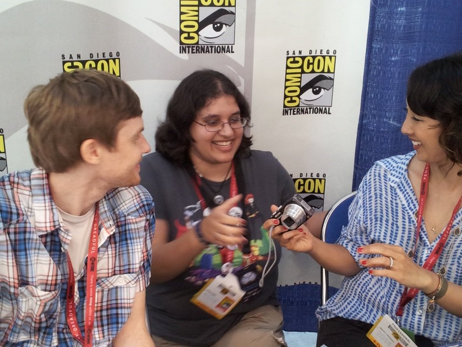 Jed Whedon and Maurissa Tancharoen hand a happy fan, Beela, her camera back after we took a photo for her. Photo credit: Timothy Elliott.
