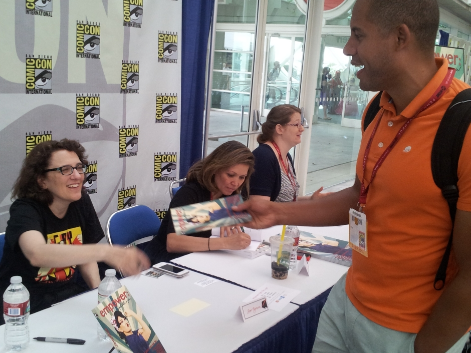 "Jane Espenson takes ""Justified"" TV writer VJ Boyd's book to sign. Pang-Ni Landrum and Jennifer Quintenz are busy signing autographs as well. Photo credit: Timothy Elliott."