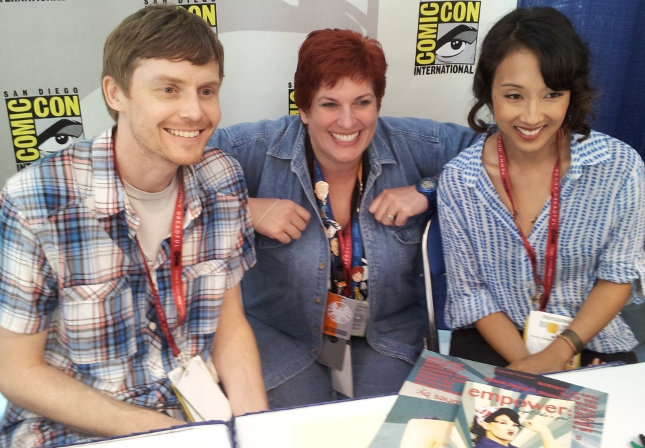 Marvel's Agents of S.H.I.E.L.D. executive producers Jed Whedon and Maurissa Tancharoen pose for a photo with Kristin Lindsay from Penny Arcade Expo. Photo credit: Timothy Elliott.