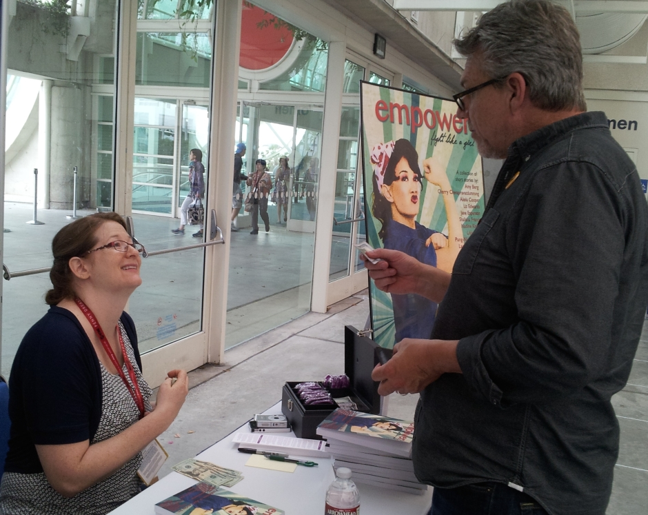 Jennifer Quintenz helps Marvel's Agents of S.H.I.E.L.D. executive producer Jeff Bell purchase a book. Photo credit: Timothy Elliott.